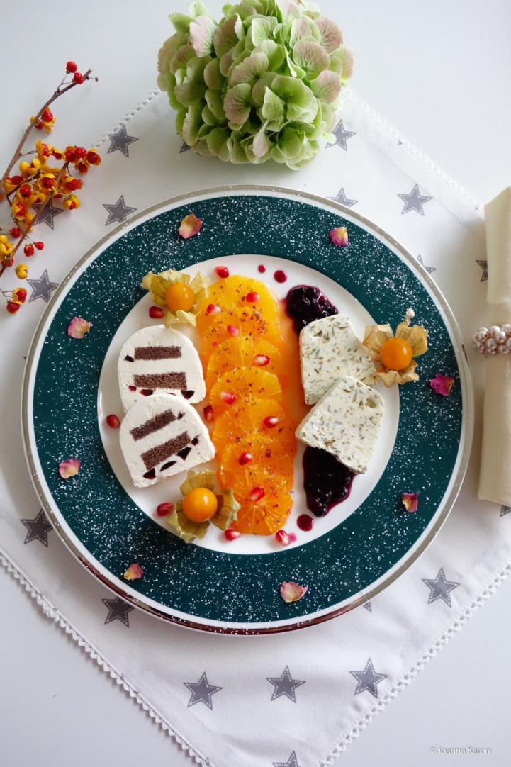 Kürbiskernparfait mit Tonkabohne auf Heidelbeeren und Orangen-Kuchen-Parfait mit Amarenakirschen auf Campari-Orangen